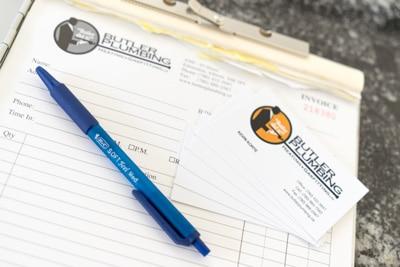 Commercial Plumbing Contractors pen and paper