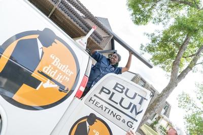 Commercial Plumbing Contractors pulling pipe off van