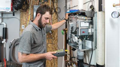 Butler plumber fixing boiler