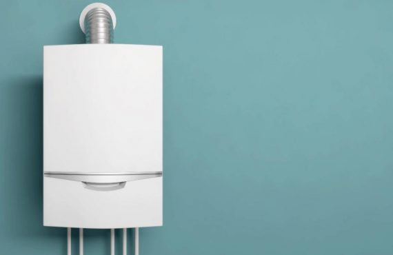 A tankless water heater against a blue wall.